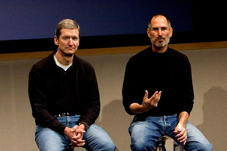 Steve Jobs sitting with Tim Cook