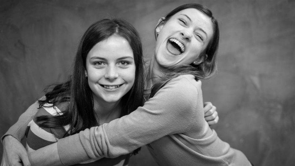 2 young girls hugging