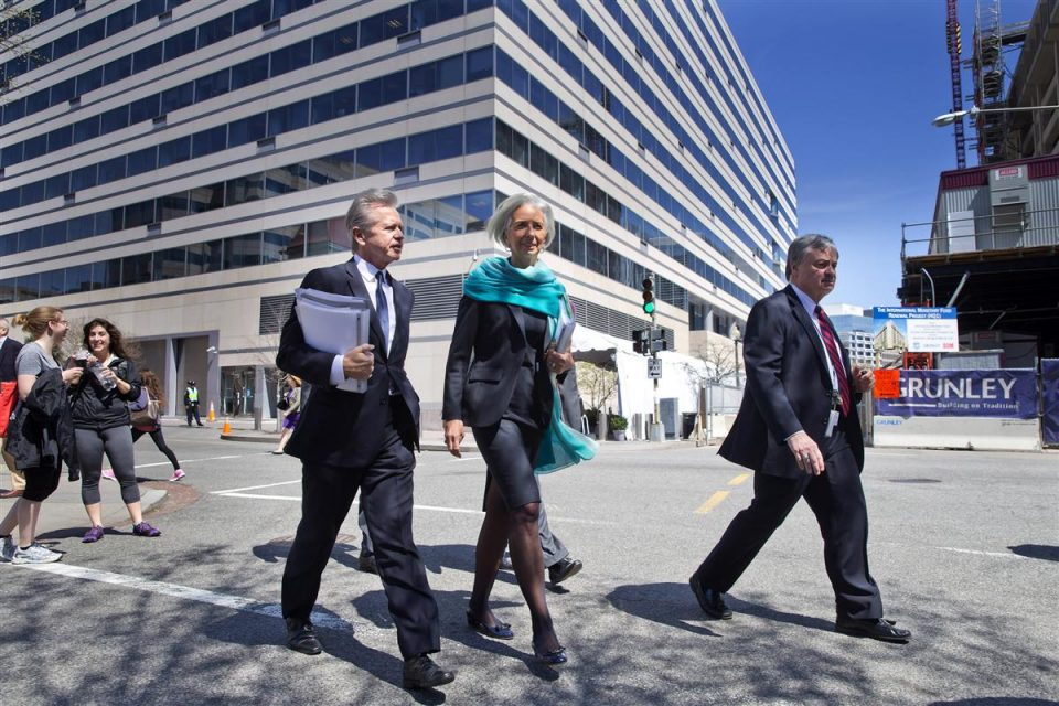 3 business men and woman walking