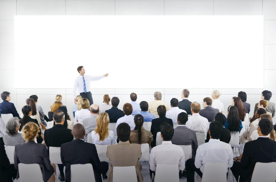 man presenting to an audience