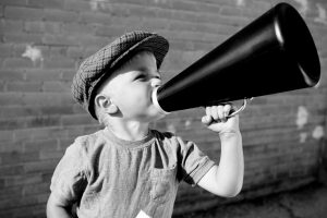 young boy with megaphone