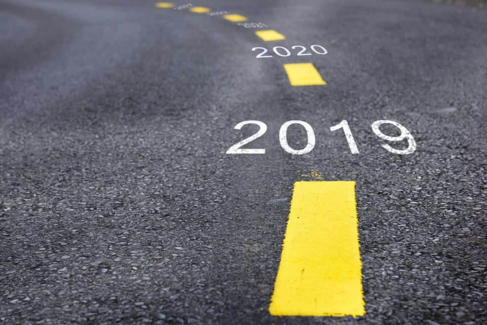 Number of 2019 to 2023 on asphalt road surface with marking lines