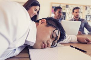 man sleeping on desk