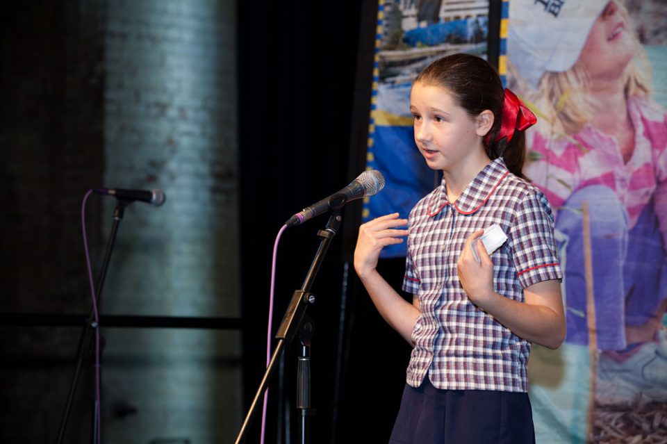 young girl presenting