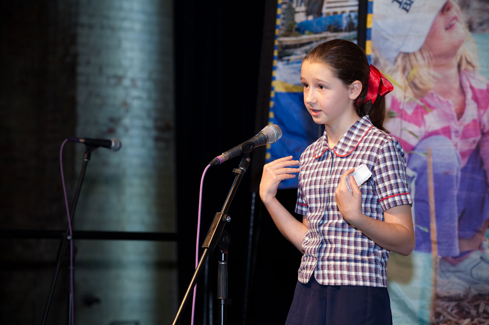 Young girl speaking with microphone