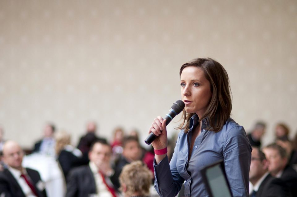 woman presenting with microphone