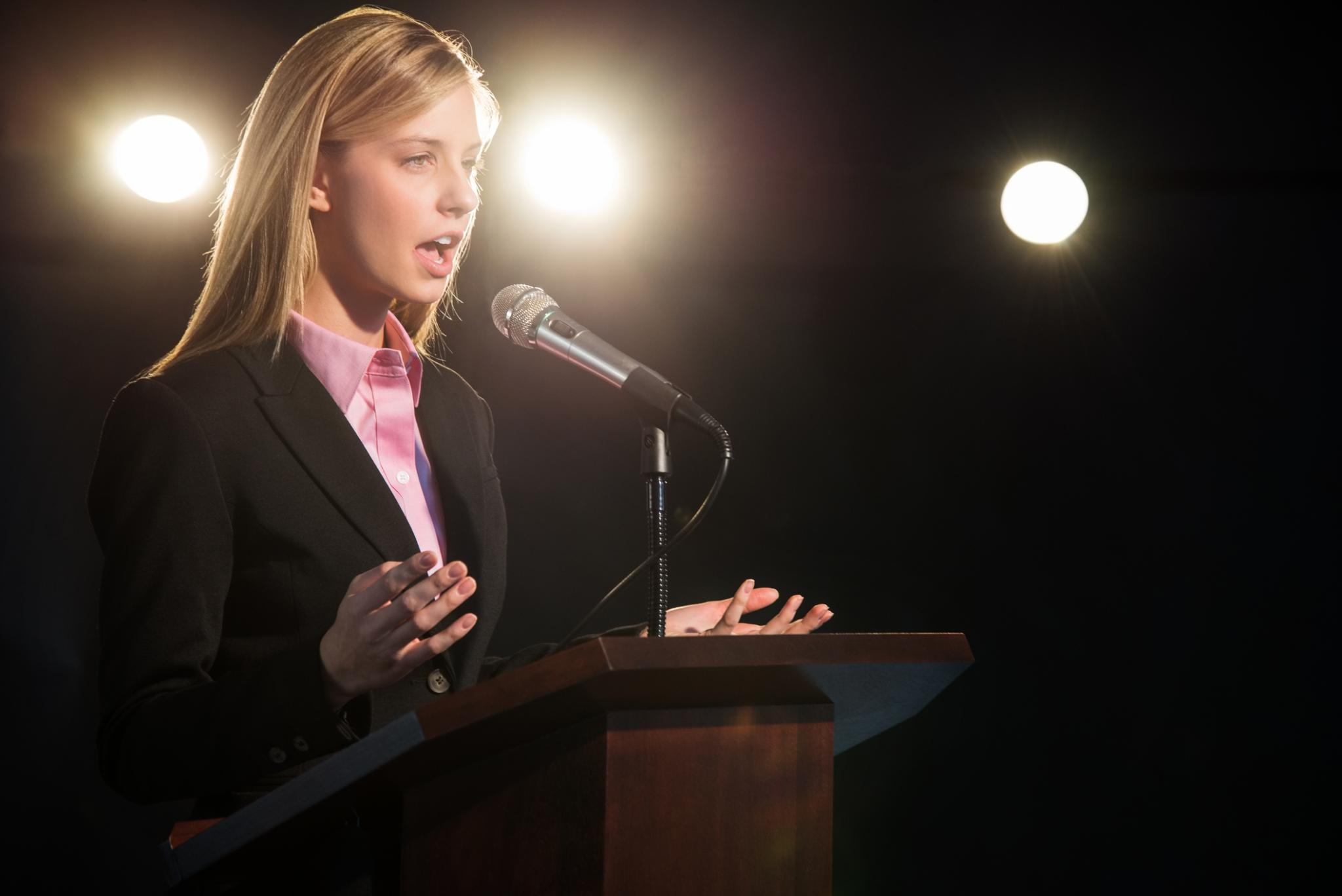Lady speaking at a conference