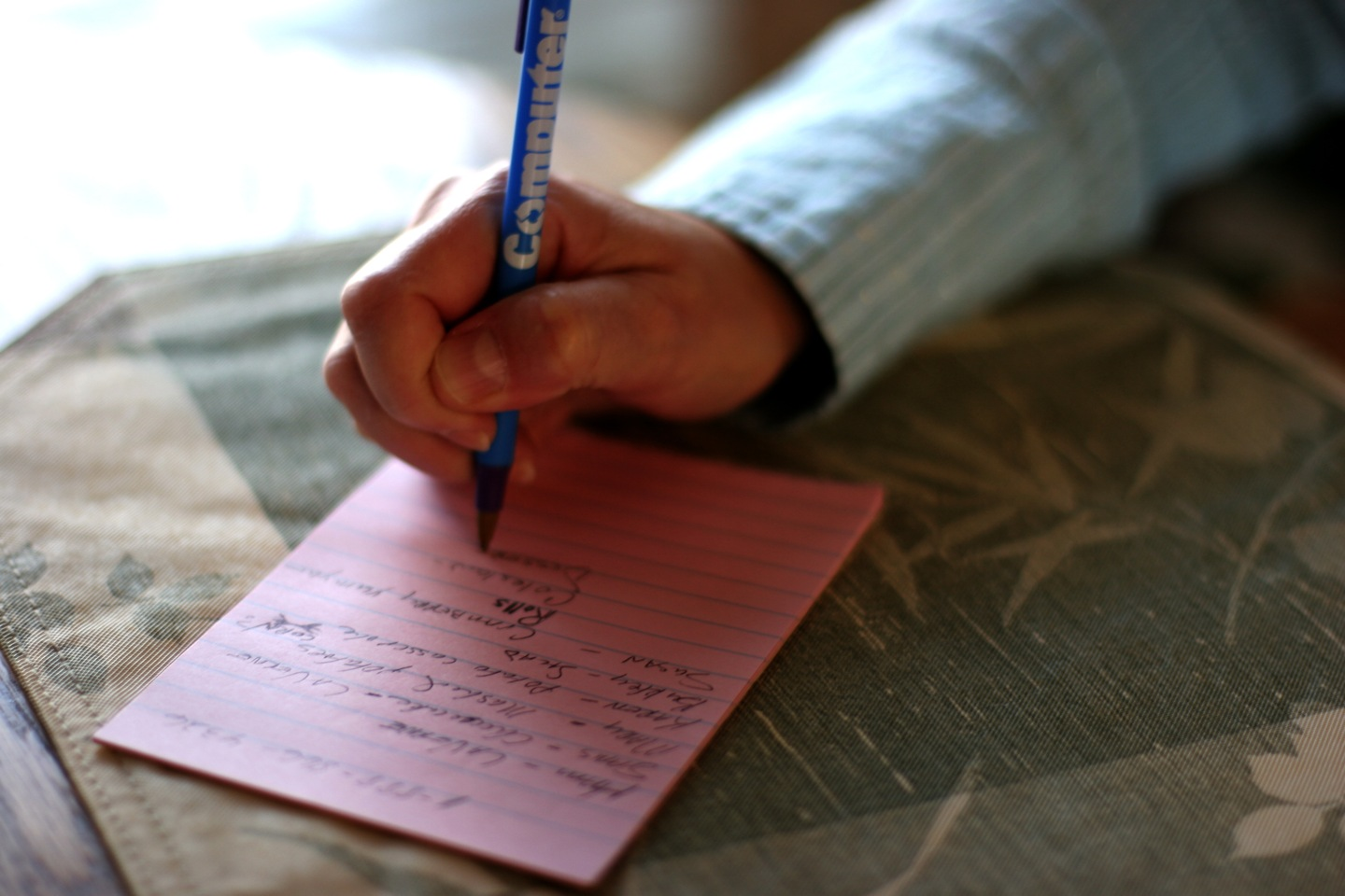 Man writing list