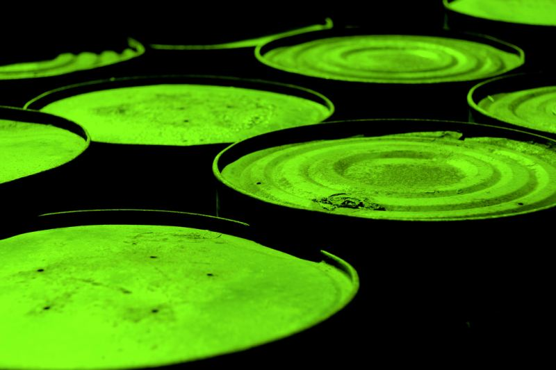 Green tubs of toxic liquid