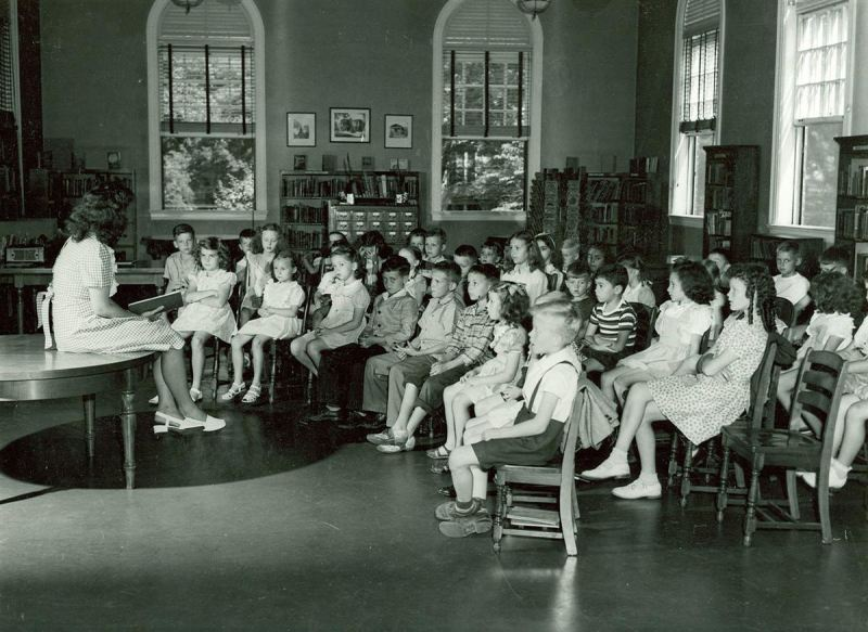 school children sitting in classroom