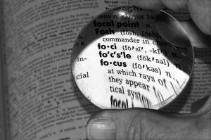 Magnifying glass on word focus