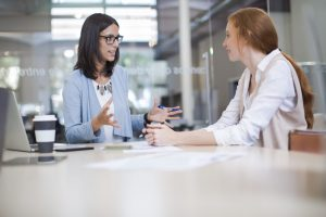 Two business women in a meeting