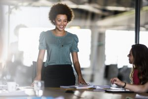 smiling businesswoman sharing ideas in meeting